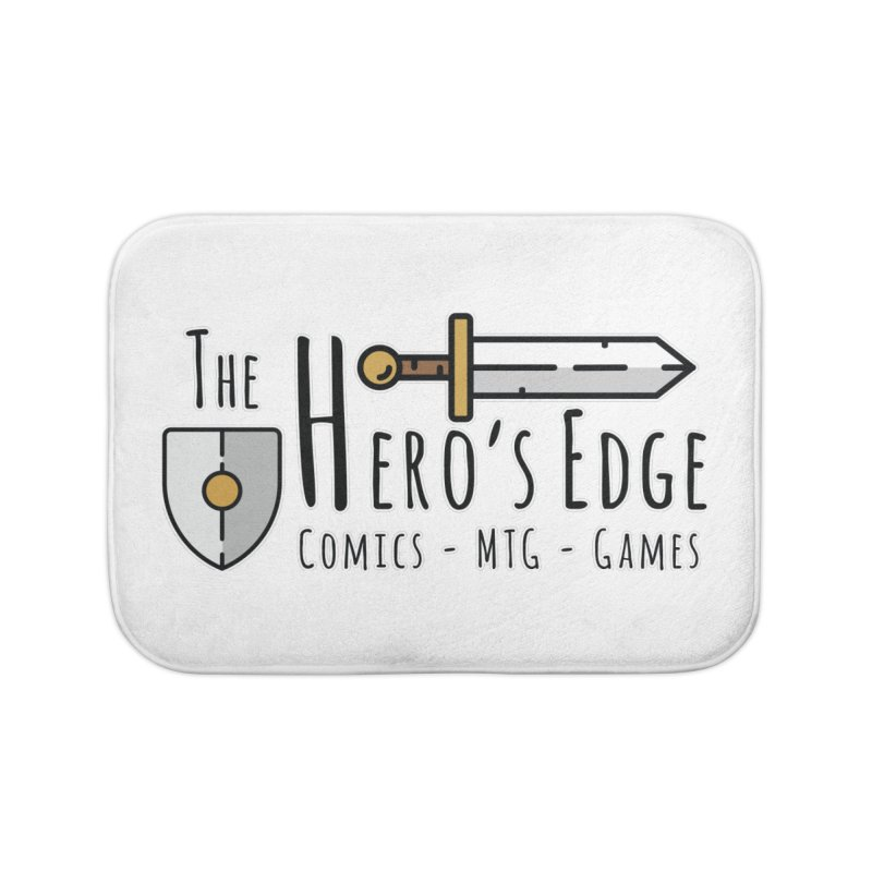 The Hero's Edge Logo Dark on Light Home Bath Mat by The Hero's Edge