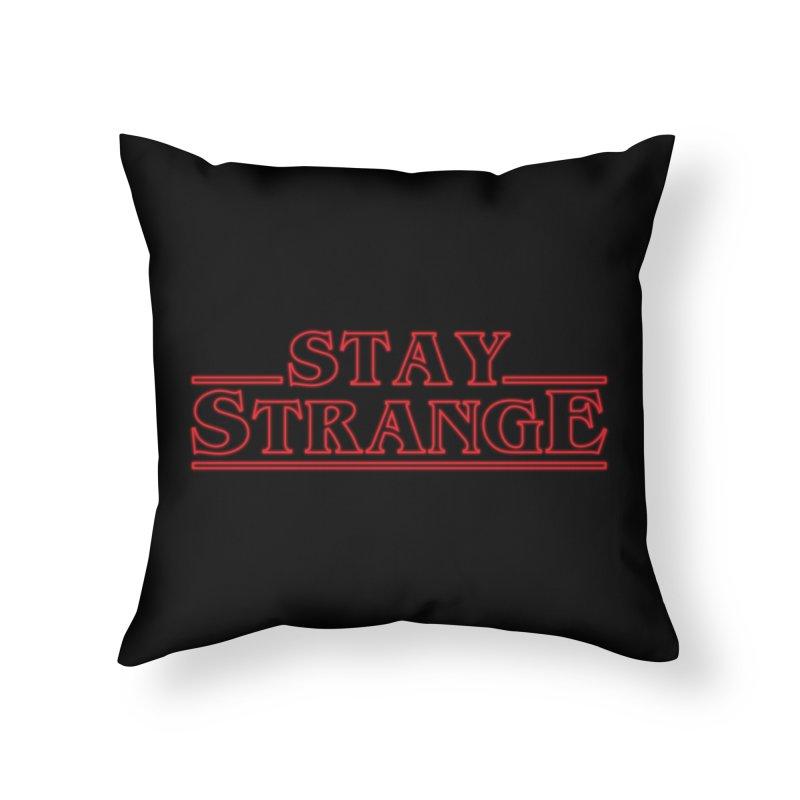 STAY STRANGE Home Throw Pillow by alchemist's Artist Shop