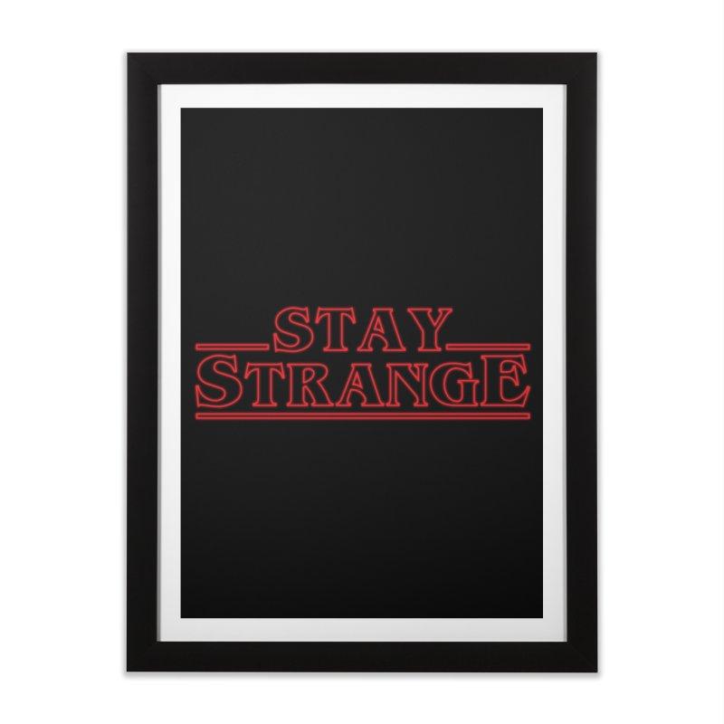 STAY STRANGE Home Framed Fine Art Print by alchemist's Artist Shop