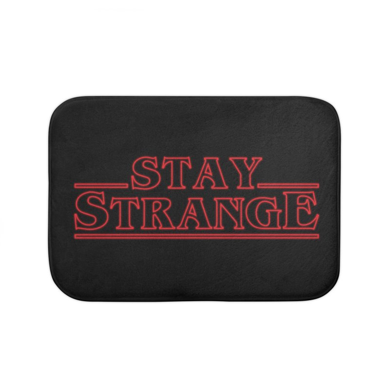 STAY STRANGE Home Bath Mat by alchemist's Artist Shop