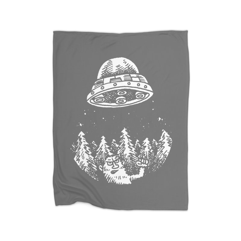 UFO buzzes Yeti in the forest Home Blanket by Anthony Woodward's Artist Shop