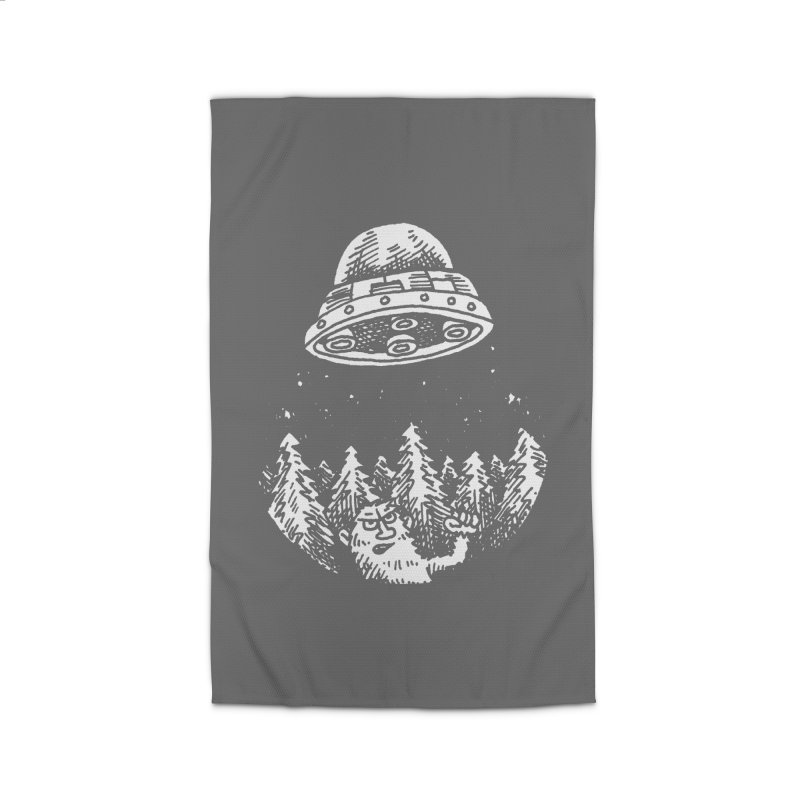 UFO buzzes Yeti in the forest Home Rug by Anthony Woodward's Artist Shop