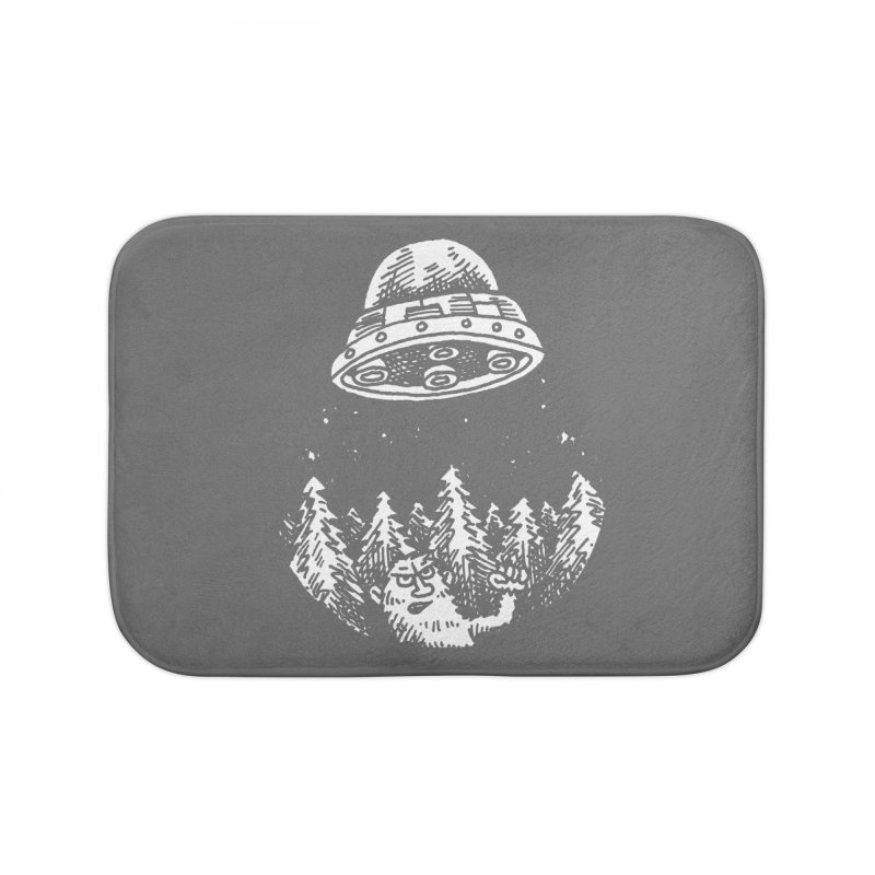 UFO buzzes Yeti in the forest Home Bath Mat by Anthony Woodward's Artist Shop