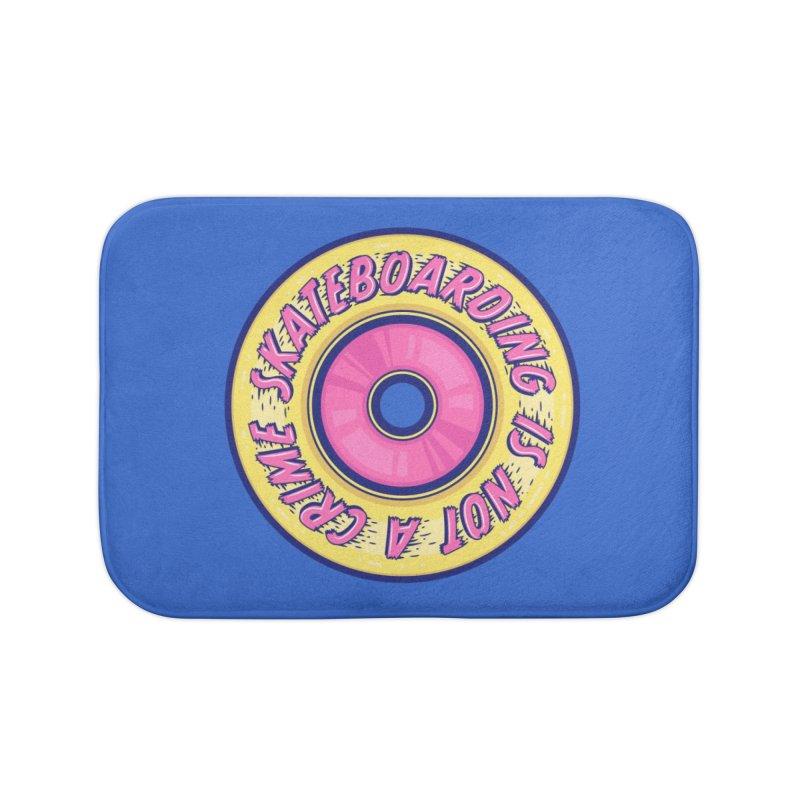 Skateboarding Is Not A Crime – Wheel Home Bath Mat by Bálooie's Artist Shop