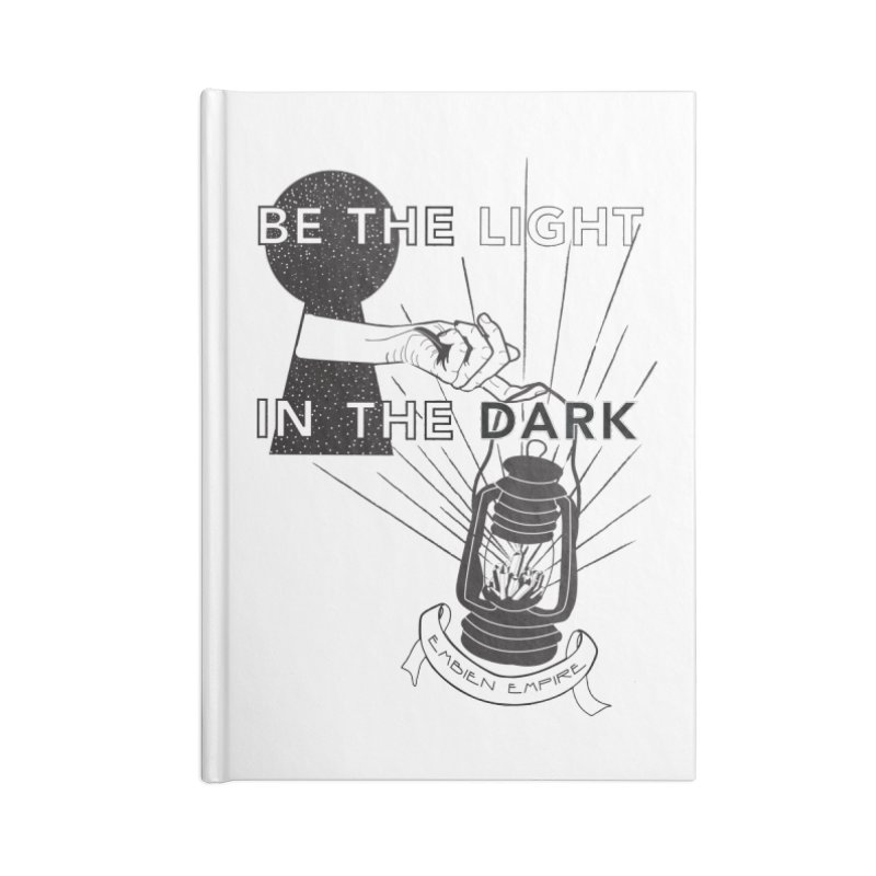 """Be the light in the dark"" in Blank Journal Notebook by The Embien Empire"