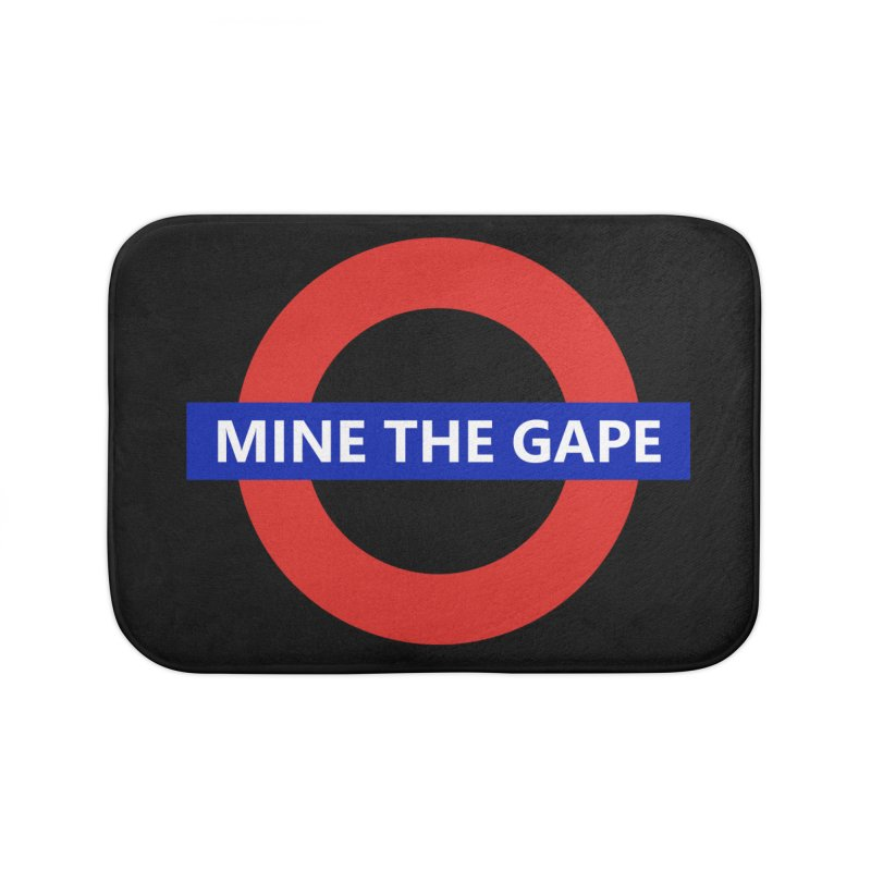 mind the gape Home Bath Mat by FredRx's Artist Shop