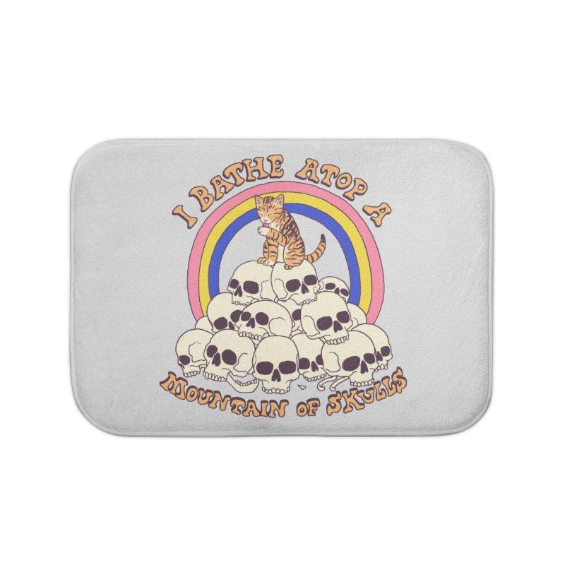 Bathe Atop A Mountain Of Skulls Home Bath Mat by Hillary White