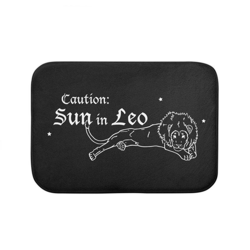 Caution: Sun in Leo Home Bath Mat by Naomi Mariko Creates