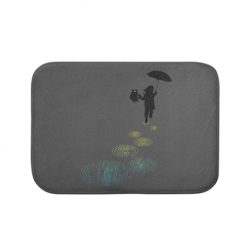 Dancing in the Rain Home Bath Mat by Niel Quisaba's Artist Shop