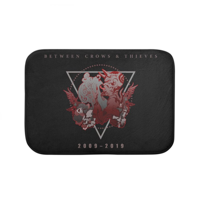 Between Crows & Thieves Anniversary logo Home Bath Mat by Norman Wilkerson