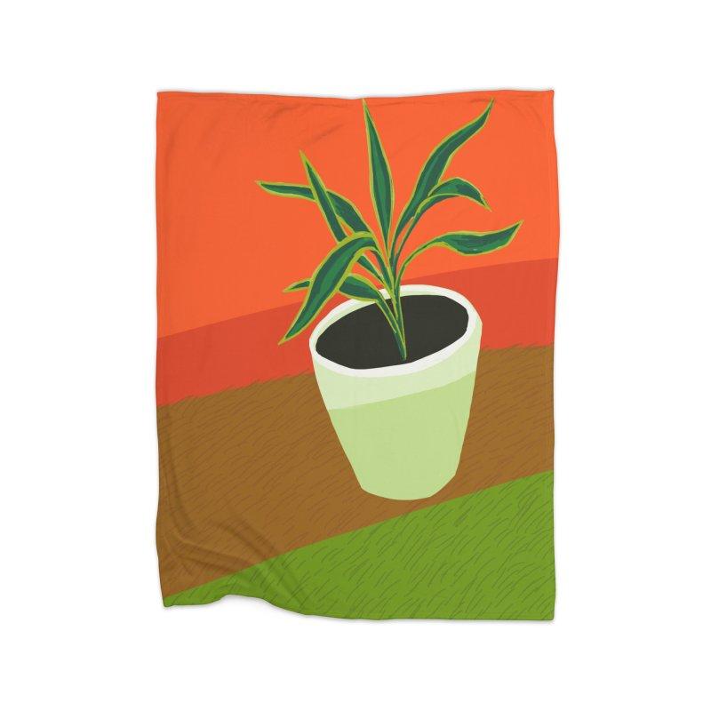Plant on Red Home Fleece Blanket Blanket by Michael Pfleghaar