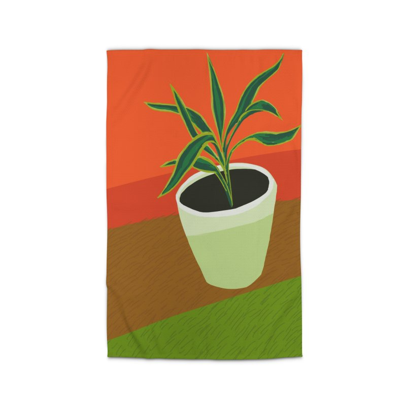 Plant on Red Home Rug by Michael Pfleghaar