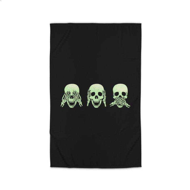 No evil skulls Home Rug by Steven Toang