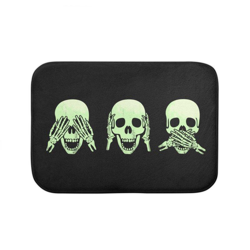 No evil skulls Home Bath Mat by Steven Toang