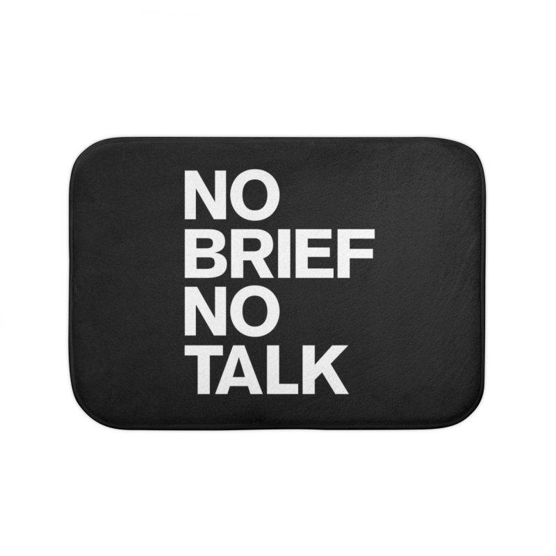 No Brief No Talk Home Bath Mat by The Incumbent Agency