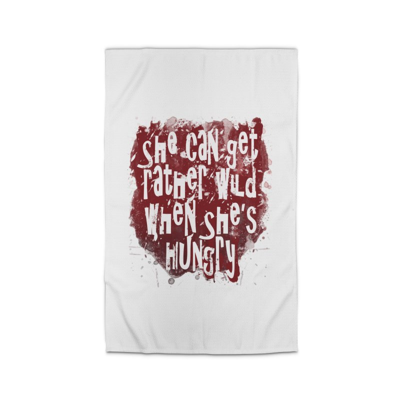 She can get rather wild when she's hungry Home Rug by Unhuman Design
