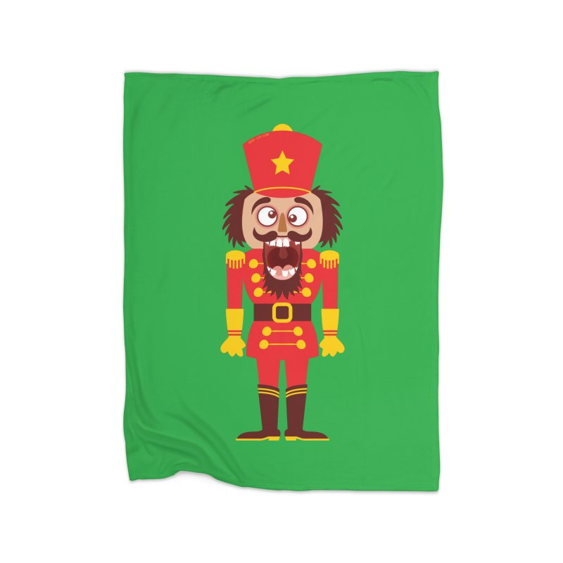 A Christmas nutcracker breaks its teeth and goes nuts Home Blanket by Zoo&co's Artist Shop